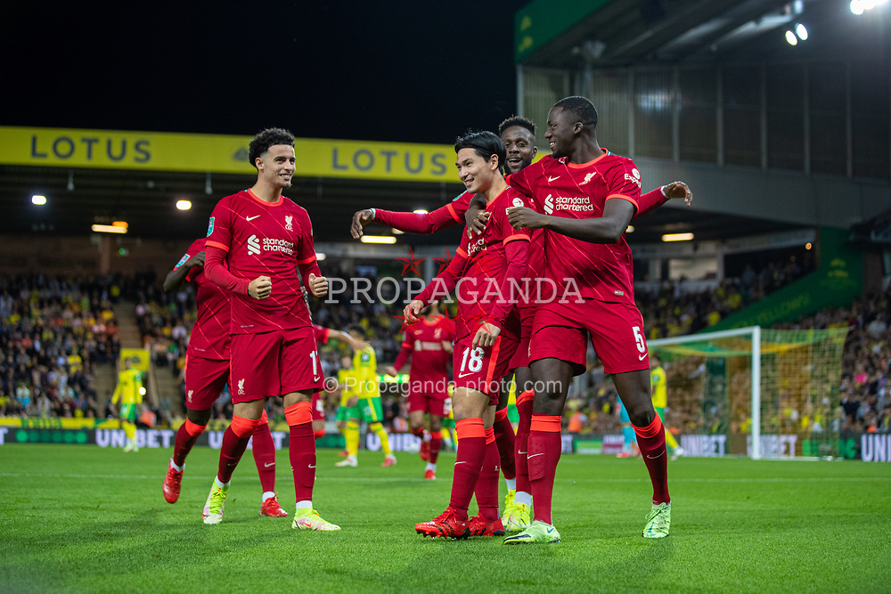 NORWICH, ENGLAND - Tuesday, September 21, 2021: Liverpool's Takumi Minamino (C) celebrates with team-mates after scoring the first goal during the Football League Cup 3rd Round match between Norwich City FC and Liverpool FC at Carrow Road. Liverpool won 3-0. (Pic by David Rawcliffe/Propaganda)