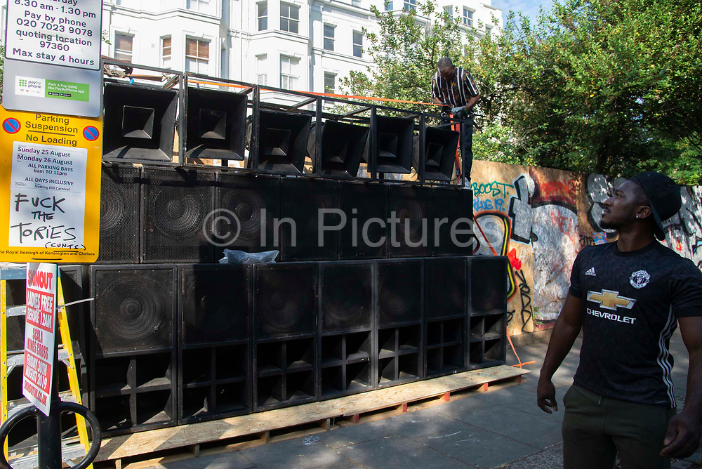 Graffiti critical of the government is seen on a lamp post as  sound system being set up at Notting Hill carnival on 25th August, 2019 in London, United Kingdom. One million people are expected on the streets in scorching temperatures for the Notting Hill Carnival, Europes largest street party and a celebration of Caribbean traditions.