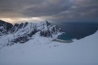 Winter view over snow covered Horseid beach from Branntuva mountain peak, Lofotodden national park, Moskenesøy, Lofoten Islands, Norway