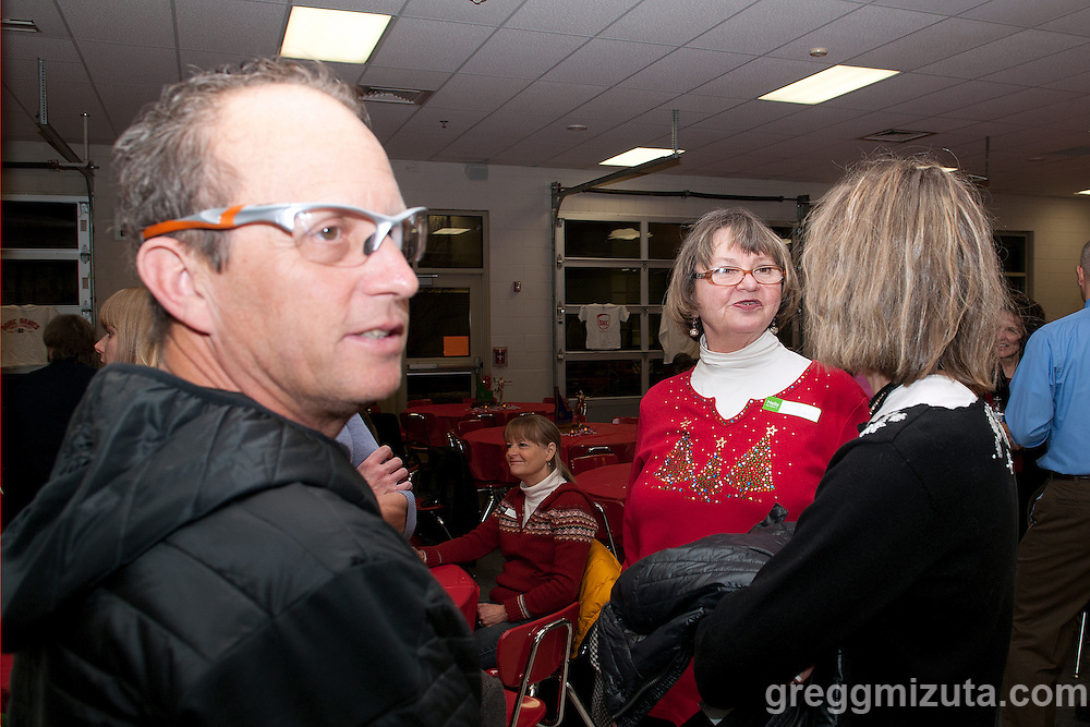 Tim Severa, Claudia Mills, and Carol Severa at Coach David Mills retirement party on December 21, 2013 at Boise High School. Dave was a cross country coach for 34 years at Boise High School