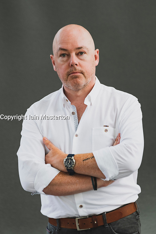 """Edinburgh, Scotland, UK. 25 August, 2018. Pictured; Author John Boyne has built on the staggering success of """"The Boy in the Striped Pyjamas"""" with a series of acclaimed novels for adults. He launches """"A Ladder to the Sky"""", a fascinating portrayal of Maurice Swift, a would-be writer who finds that literary success can come by stealing stories."""