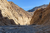 Two hikers make their way up Mosaic Canyon near Stovepipe Wells in Death Valley National Park.