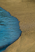Detail of small waves at waters edge, Dudley Beach, near Newcastle Australia