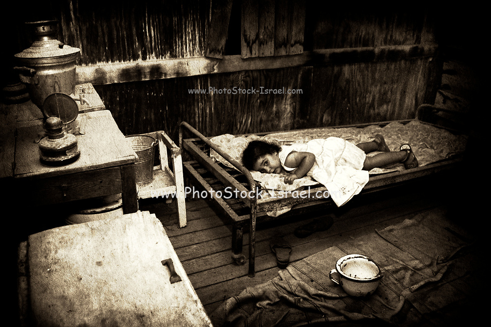 Concept poverty image a young girl of 4 in a poor and desolate, rundown surroundings