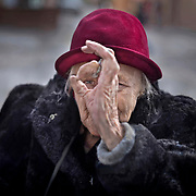 """After making a candid image of this lady she playfully pulled out what she called her """"camera"""" to photograph me in Gdansk, Poland.<br />  (Leica M10  Summicron 50 mm APO)"""