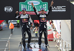 Sebastien Ogier of France and Julien Ingrassia of France celebrate winning the World Championship in the M-Sport WRT Ford Fiesta WRC during day four of the Dayinsure Wales Rally GB.
