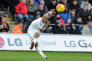 Swansea City's Andre Ayew takes a wayward shot at goal. Barclays Premier league match, Swansea city v Norwich city at the Liberty Stadium in Swansea, South Wales on Saturday 5th March 2016.<br /> pic by  Carl Robertson, Andrew Orchard sports photography.
