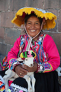 """They call them """"llamitas"""" because often bring with them a lama, but you can more easily see with a lamb in her arms. Dressed in their traditional clothes, that in their villages of origin are the dress of everydays, this ladies have realized that you can earn from the pictures. As the local models are proposed to pose with or without tourists, the price is """"su voluntad"""" ( just a tip) but always a little angry' when the will is only a couple of nuevo soles (60 cents)"""