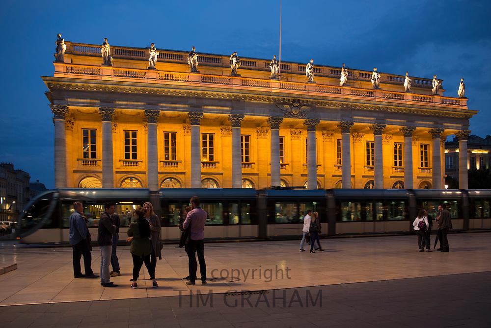 People and tram by the Grand Theatre - Opera National de Bordeaux, Place de la Comedie, Bordeaux, France