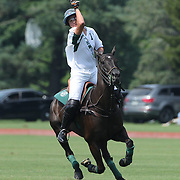 Santino Magrini, White Birch, in action during the White Birch Vs K.I.G Polo match in the Butler Handicap Tournament match at the Greenwich Polo Club. White Birch won the game 11-8. Greenwich Polo Club,  Greenwich, Connecticut, USA. 12th July 2015. Photo Tim Clayton