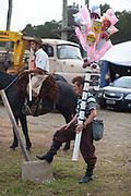 Brazilian male gaucho cowboy selling baloons, Gaucho cowboy Rodeo, Flores de Cunha, Rio Grande do Sul.