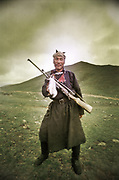 "A Marmot hunter, dressed in apparel,  near Zagastain Davaa, the ""Fish Pass"" in Zavkhan Aimag. Mongolia."