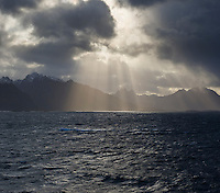 Dramatic light over mountains of Vesterålen and Lofoten as viewed from ferry