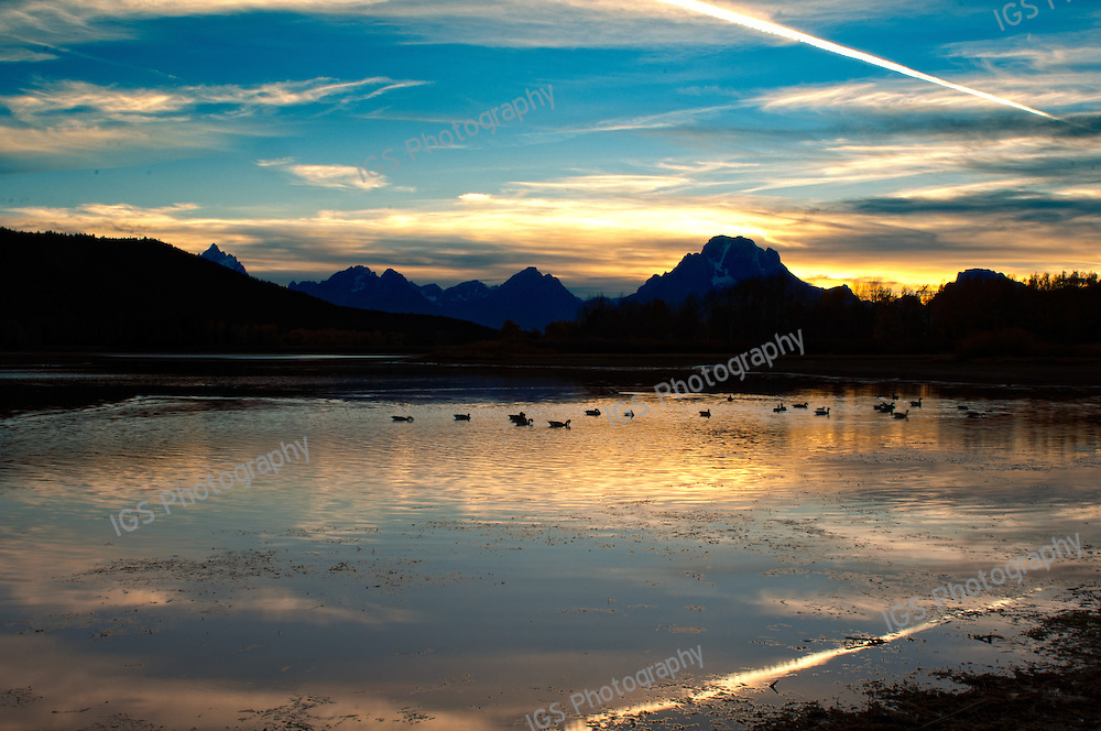 Jet Contrails over the Tetons at Sunset