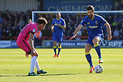 AFC Wimbledon defender Jon Meades (3) taking on Southend United midfielder Will Atkinson (12) during the EFL Sky Bet League 1 match between AFC Wimbledon and Southend United at the Cherry Red Records Stadium, Kingston, England on 25 March 2017. Photo by Matthew Redman.