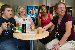 Students with learning disabilities and staff taking a break from lessons at special school,