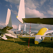 Visitors to the world's largest aviation airshow at Oshkosh, Wisconsin, USA, admire home-built kit aeroplanes at Oshkosh Air Venture, the world's largest air show in Wisconsin USA. Close to a million people populate the mass fly-in over the week, a pilgrimage worshipping all aspects of flight. The event annually generates $85 million in revenue over a 25 mile radius from Oshkosh. The event is presented by the Experimental Aircraft Association (EAA), a national/international organization based in Oshkosh. The airshow is seven days long and typically begins on the last Monday in July. The airport's control tower is the busiest control tower in the world during the gathering.