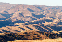Shadows and ridges in morning sun, Ladder Ranch, west of Truth or Consequences, New Mexico, USA.