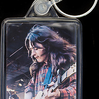 Rory Gallagher - Key Fob with image approx. 35mm x 50mm from 1970 Isle of Wight Music Festival exhibition on the front. The reverse has an exclusive CameronLife  1970 IW festival design