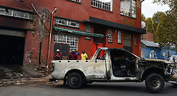 A burnt vehicle is seen at the site of xenophobic attacks in Johannesburg Town, South Africa, on April 17, 2015. South African police on Friday fired rubber bullets to disperse rioters in central Johannesburg, a fresh hotbed of xenophobia violence. The current spate of xenophobic violence mainly affects Durban and Johannesburg. According to official figures, five people have been killed and thousands of immigrants displaced. EXPA Pictures © 2015, PhotoCredit: EXPA/ Photoshot/ Zhai Jianlan<br /> <br /> *****ATTENTION - for AUT, SLO, CRO, SRB, BIH, MAZ only*****