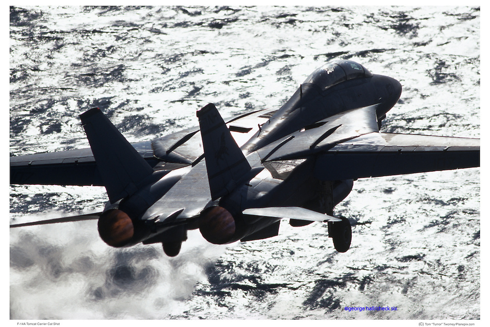 F-14 taking off from aircraft carrier
