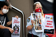 A demonstrator holds up graphic images during the AFP Stop Training Killers protest organised by Make West Papua Safe organisation. The organisation believes the AFP trains with Indonesian riot police BriMob and counter-terrorist police D88, who are reportedly notorious killers in West Papua, responsible for execution-style murders, torture and other crimes. (Photo by Mikko Robles/Speed Media)