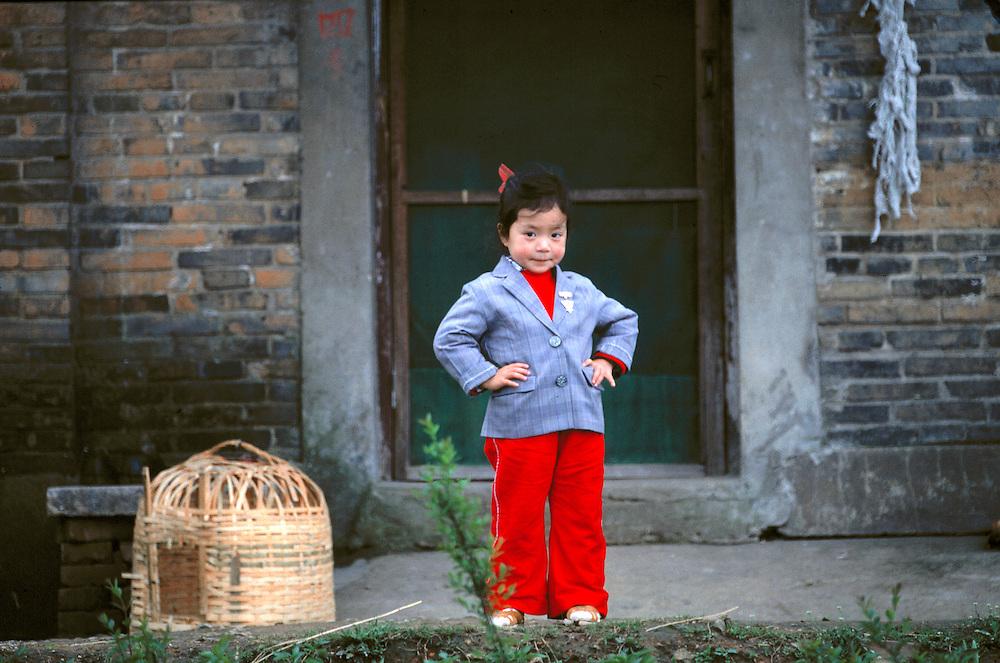 A spunky Chinese girl poses for the camera, Hangzhou, Zhejiang, China.