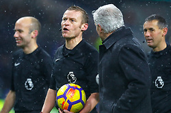 """Stoke City manager Mark Hughes speaks with referee Michael Jones as he leaves the pith at half time of the Premier League match at Turf Moor, Burnley. PRESS ASSOCIATION Photo. Picture date: Tuesday December 12, 2017. See PA story SOCCER Burnley. Photo credit should read: Martin Rickett/PA Wire. RESTRICTIONS: EDITORIAL USE ONLY No use with unauthorised audio, video, data, fixture lists, club/league logos or """"live"""" services. Online in-match use limited to 75 images, no video emulation. No use in betting, games or single club/league/player publications."""