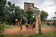 Locals play a game of basketaball on a dirt court in a village outside Puerto Princesa on the island of Palawan in the Philippines. (July 4, 2019)