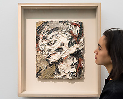 """© Licensed to London News Pictures. 01/11/2016. London, UK. A staff member views """"Head of Gerda Boehm"""" by Frank Auerbach, a much loved favourite of David Bowie's, est. GBP300-500k. The first look of """"Bowie / Collector"""", artworks from the late David Bowie's personal art collection, ahead of their sale later this month at Sotheby's. Photo credit : Stephen Chung/LNP"""