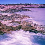 Waves crashing on the rocky coast of Appledore Island. Isles of Shoals. Maine