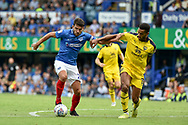 Portsmouth Midfielder, Gareth Evans (26) gets away from Oxford United Defender, Curtis Nelson (5) during the EFL Sky Bet League 1 match between Portsmouth and Oxford United at Fratton Park, Portsmouth, England on 18 August 2018.