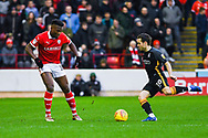 Dimitri Cavaré of Barnsley (12) and Jack Payne of Bradford City (10) face off for the loose ball during the EFL Sky Bet League 1 match between Barnsley and Bradford City at Oakwell, Barnsley, England on 12 January 2019.