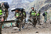 TIBET, CHINA - APRIL 28: (CHINA OUT)<br /> <br />  Border soldiers press forward Zhangmu Town which lose contact with outside world for 70 hours after 8.1-magnitude earthquake hitting Nepal and spreading to Tibet on April 28, 2015 in Tibet Autonomous Region, China. A major 7.8 earthquake hit Kathmandu mid-day on Saturday, and was followed by multiple aftershocks that triggered avalanches on Mt. Everest that buried mountain climbers in their base camps. Many houses, buildings and temples in the capital were destroyed during the earthquake, leaving thousands dead or trapped under the debris as emergency rescue workers attempt to clear debris and find survivors. Regular aftershocks have hampered recovery missions as locals, officials and aid workers attempt to recover bodies from the rubble<br /> ©Exclusivepix media