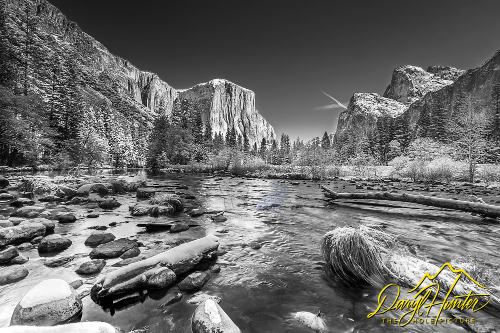 Fresh autumn snow and the Merced River as it winds through Yosemite Valley at Valley View in Yosemite National Park.
