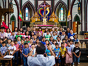 26 NOVEMBER 2017 - YANGON, MYANMAR: A children's choir rehearses in St. Mary's Cathedral in Yangon before the visit of Pope Francis to Myanmar. The Pope will visit Yangon November 27 - 30. He will have private meetings  with government officials, military leaders and Buddhist clergy. He will also participate in two masses, a public mass in a sports complex on November 29 and a mass for Myanmar youth in St. Mary's Cathedral on November 30.    PHOTO BY JACK KURTZ