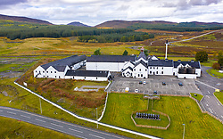 Aerial view of Dalwhinnie Distillery in Scottish Highlands, Scotland, UK