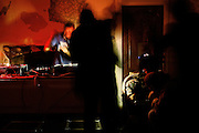 Zil, 23, from Poland, (right) is playing records at a party in the Ingram Avenue mansion, on Saturday, Oct. 6, 2007, in Hampstead, London, England, while a couple of ravers are preparing lines of the drug speed on his right. The 22-room mansion was last sold for UK£ 3.9M in 2002 and is now awaiting planning permissions to be demolished. Two new houses will soon be taking its place. Million Dollar Squatters is a documentary project in the lives of a peculiar group of squatters residing in three multi-million mansions in one of the classiest residential neighbourhoods of London, Hampstead Garden. The squatters' enthusiasm, their constant efforts to look after what has become their home, their ingenuity and adventurous spirit have all inspired me throughout the days and nights spent at their side. Between the fantasy world of exclusive Britain and the reality of squatting in London, I have been a witness to their unique story. While more than 100.000 properties in London still lay empty to this day, squatting provides a valid, and lawful alternative to paying Europe's most expensive rent prices, as well as offering the challenge of an adventurous lifestyle in the capital.