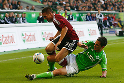 15.10.2011,Volkswagen Arena, Wolfsburg, GER, 1.FBL,VfL Wolfsburg vs 1. FC Nuernberg , im Bild  Marcel Schaefer (Wolfsburg #4) foult Robert Mak (Nuernberg #14) .// during the match from GER, 1.FBL, VfL Wolfsburg vs 1. FC Nuernberg  on 2011/10/15, Volkswagen Arena, Wolfsburg, Germany..EXPA Pictures © 2011, PhotoCredit: EXPA/ nph/  Schrader       ****** out of GER / CRO  / BEL ******