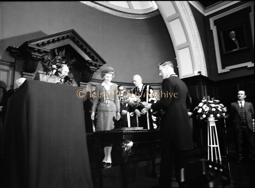 Nancy Reagan .Visits the Royal College Of Surgeons..St Stephens Green,.1984..04.06.1984.06.04.1984.4th June 1984..Nancy Reagan visited the Royal College of Surgeons where she unveilled a portrait of her late father.Her father, Dr Loyal Davis was an Honorary Fellow of the college. Mrs Reagan then presented the portrait to the college..Photograph of Mrs Nancy Reagan as the college mace is presented and laid on the table.