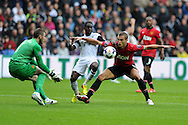 Swansea city's Nathan Dyer is denied by Man Utd's  keeper David de Gea and Nemanja Vidic.. Barclays Premier league, Swansea city v Manchester Utd in Swansea, South Wales on Saturday 17th August 2013. pic by Andrew Orchard ,Andrew Orchard sports photography,