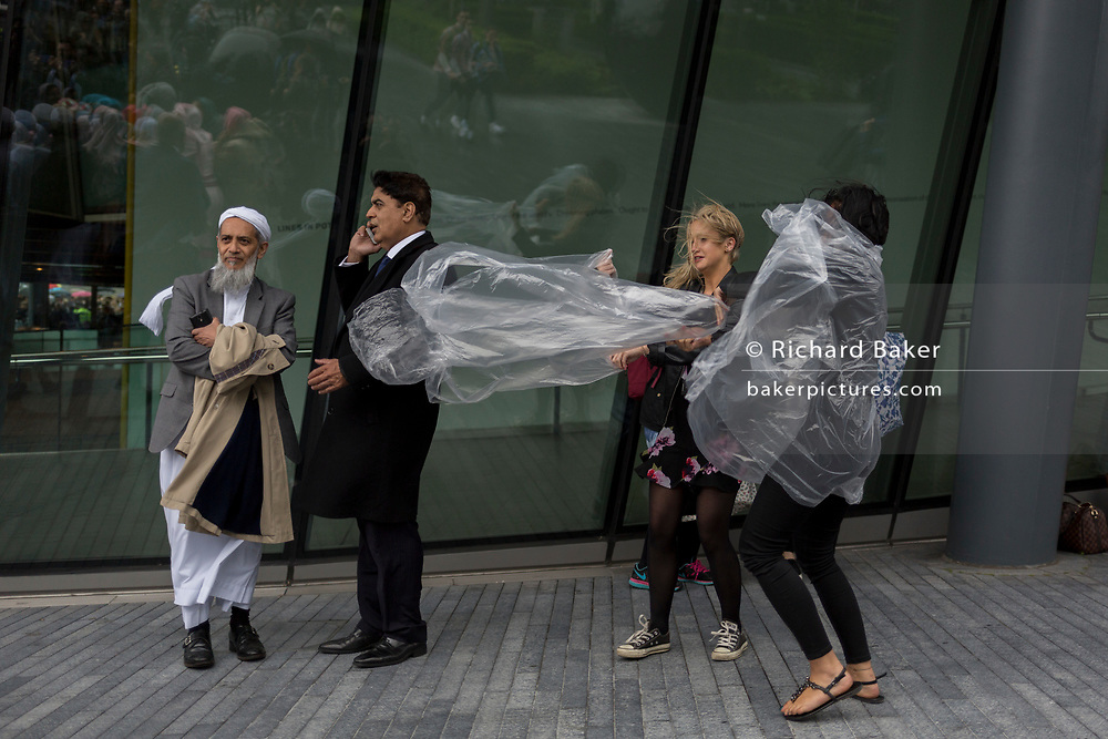 Two days after the London Bridge and Borough Market terrorist attack, Londoners from all faiths and religions attended a vigil outside City Hall, on Monday 5th June 2017, in the south London borough of Southwark, England. As gusts of wind blew umbrellas and polythene ponchos, a prominent armed police presence guarded dignitaries and the public who came to the Southbank to remember the seven killed and many others left with life-changing injuries. The British spirit of defiance and to carry on with every day life, endures.
