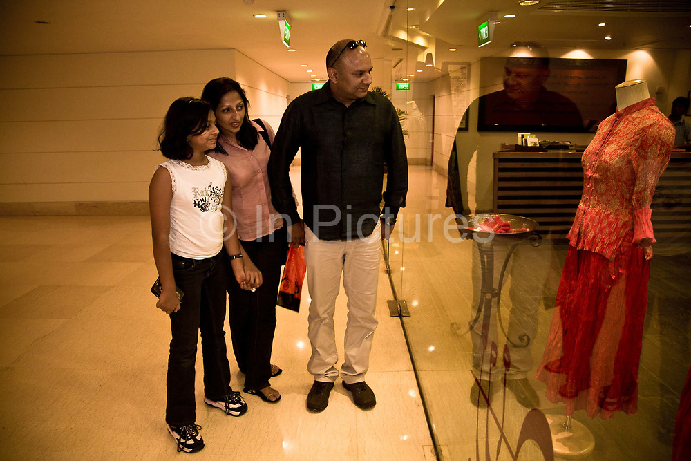 IT consultant, Bejoy George together with his wife, Bina and daughetr Nethra visit Leela shopping mall in Bangalore, India.