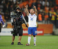 Football - 2010 FIFA World Cup - Netherlands vs. Cameroon<br /> Wesley Sneijder of the Netherlands celebrates their win and qualification to the second round top of their group at the final whistle at Green Point Stadium, Cape Town