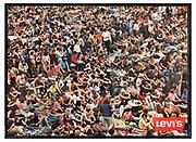 Nederland, Nijmegen, 24-6-2020  Reproductie van een Levi's poster, affiche, van het publiek op het Holland popfestival 1970 in het Kralingse bos, Rotterdam . Het festival wordt de moeder van de nederlandse festivals genoemd . Hij hing in 1971 winkels waar spijkerkleding en andere Levi Strauss kleding werd verkocht.Groter bestand beschikbaar indien gewenst .Reproductiefoto: Flip Franssen