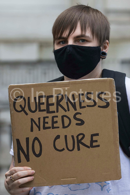 A campaigner against LGBT+ conversion therapy attends a picket outside the Cabinet Office and Government Equalities Office on 23rd June 2021 in London, United Kingdom. The campaigners, represented by LGBT+ and human rights campaigner Peter Tatchell, Revd Colin Coward and Jayne Ozanne of the Ban Conversion Therapy Coalition, also handed in a petition signed by 7,500 people calling on the government to fulfil its promise made in July 2018 to ban LGBT+ conversion therapy. LGBT+ conversion treatments, which have been linked to anxiety, depression and self-harm, have been condemned by major UK medical, psychological and counselling organisations.
