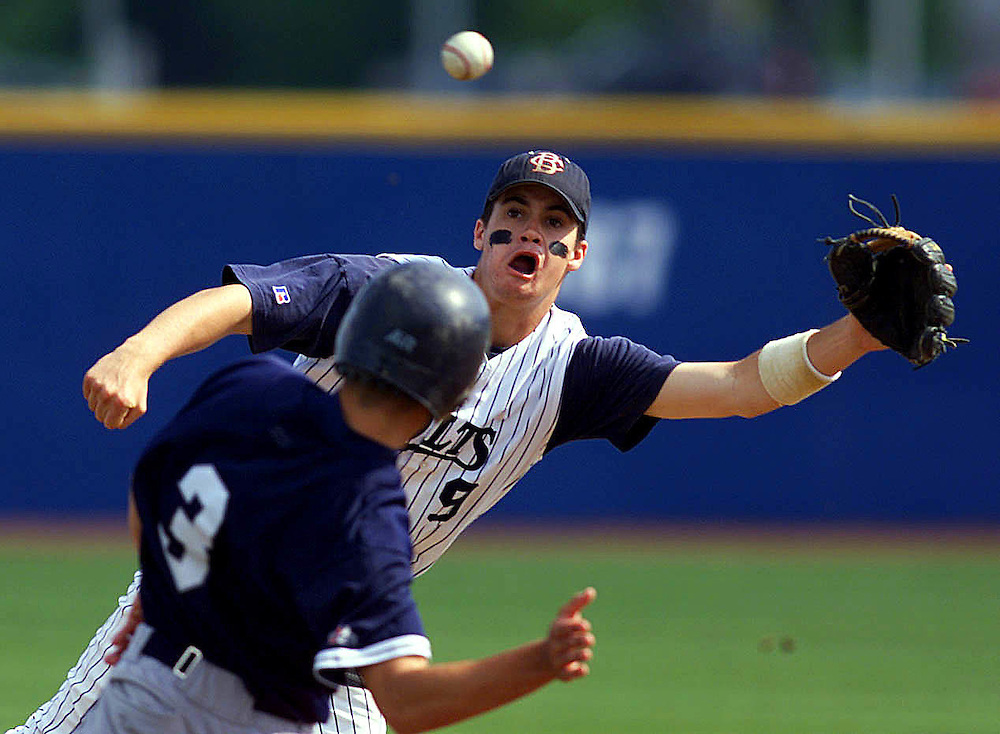 (SPORTS) East Brunswick 6/9/2001  CBA's  second baseman # 9 Chris Lillis tries to snag a errand throw by the catcher Lou Santangelo who is trying to throw out Seton Hall Prep's # 3 Chris Gamarekian.  The ball sailed into center field.  The runner was safe at second and did not advance on the bad throw.    Michael J. Treola Staff Photographer...MJT