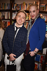 Left to right, John Galea and Lewis-Duncan Weedon at a party to celebrate the publication of Saving The World by Paola Diana at Daunt Books, Marylebone, London England. 2 May 2018.