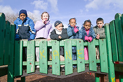 Multiracial group of children having fun at an adventure playground,