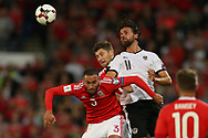 Jazz Richards (l) and Ben Davies of Wales © jump for a header with Martin Harnik of Austria. Wales v Austria , FIFA World Cup qualifier , European group D match at the Cardiff city Stadium in Cardiff , South Wales on Saturday 2nd September 2017. pic by Andrew Orchard, Andrew Orchard sports photography
